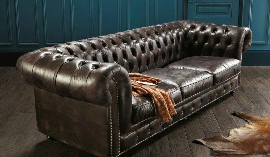 Canapé type Chesterfield en cuir vintage avec revêtement capitonné